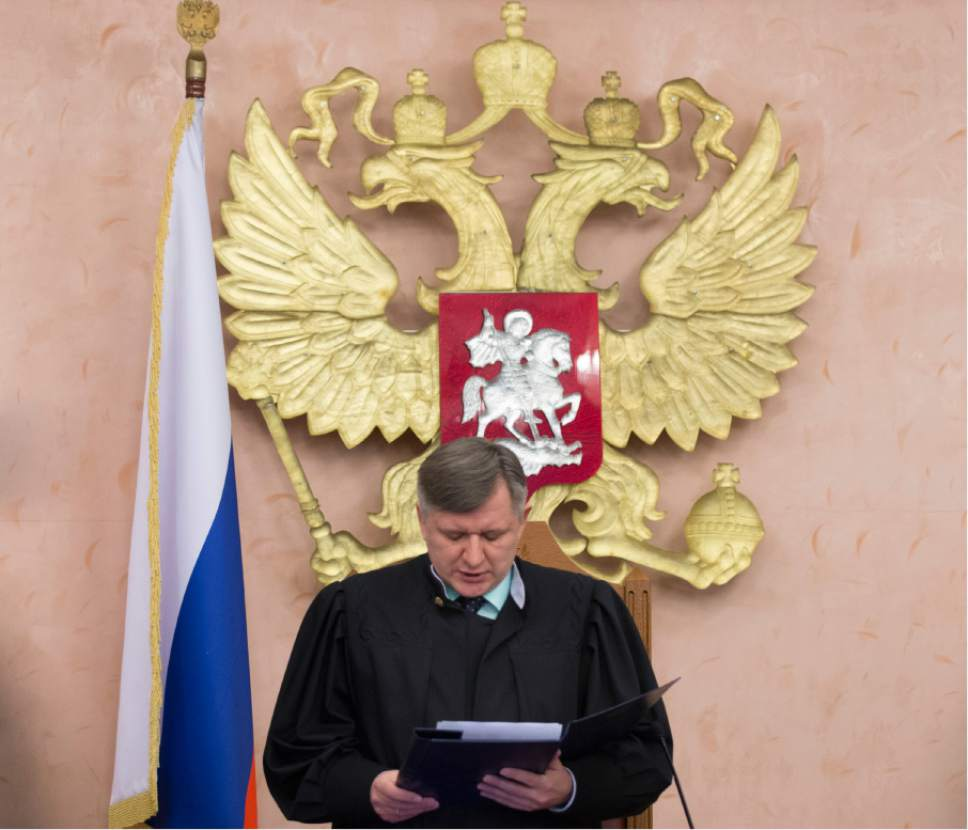 Russia's Supreme Court judge Yuri Ivanenko reads the decision in a court room in Moscow, Russia, on Thursday, April 20, 2017.  Russia's Supreme Court has banned the Jehovah's Witnesses from operating in the country, accepting a request from the justice ministry that the religious organisation be considered an extremist group, ordering closure of the group's Russia headquarters and its 395 local chapters, as well as the seizure of its property. (AP Photo/Ivan Sekretarev)
