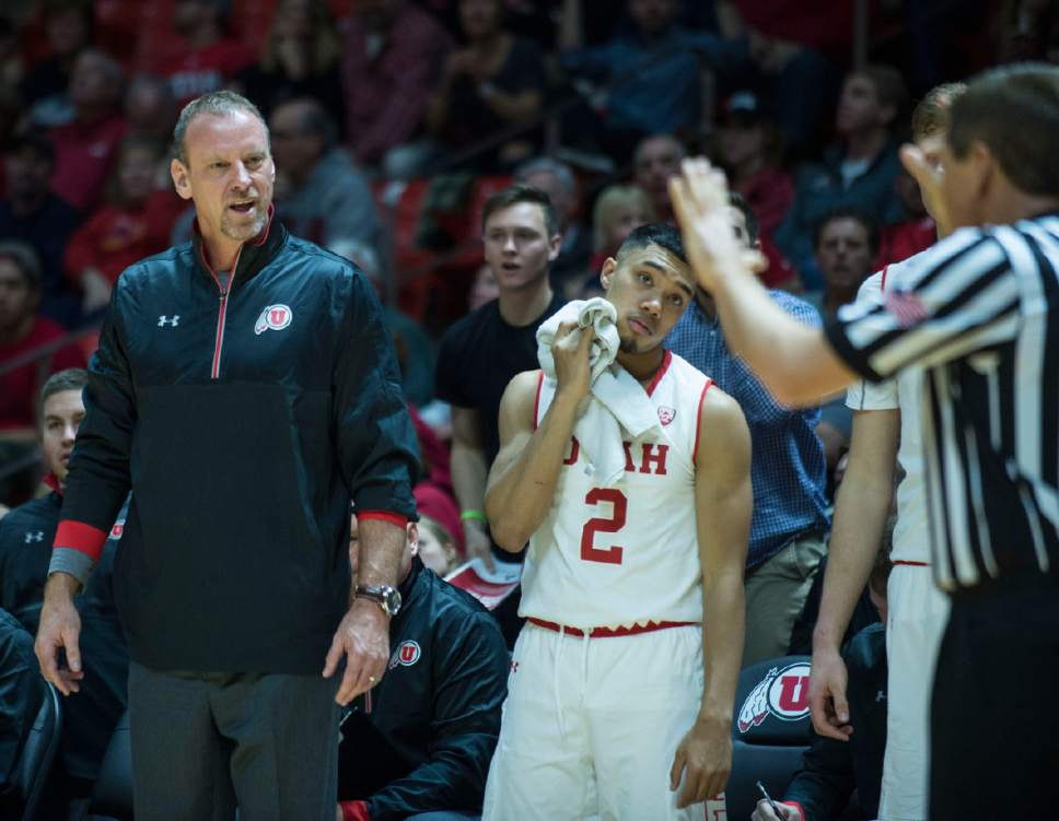 Lennie Mahler  |  The Salt Lake Tribune  Utah head coach Larry Krystkowiak and Sedrick Barefield look at an official in disbelief after an offensive foul call during a game between Utah and Washington State at the Huntsman Center in Salt Lake City, Thursday, Feb. 9, 2017.