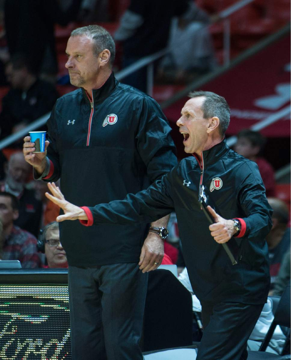 Lennie Mahler  |  The Salt Lake Tribune  Utah head coach Larry Krystkowiak and assistant coach Tommy Connor motion to players during a game between Utah and Washington State at the Huntsman Center in Salt Lake City, Thursday, Feb. 9, 2017.