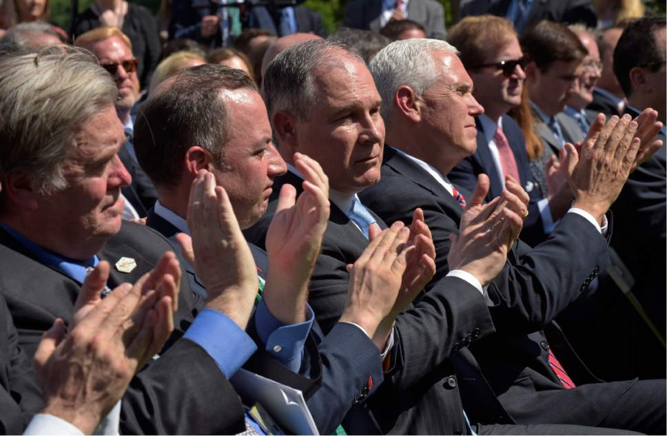 Administration officials, from left, White House chief strategist Steve Bannon, Chief of Staff Reince Priebus, Environmental Protection Agency Administrator Scott Pruitt, and Vice President Mike Pence, applaud as President Donald Trump announces that the U.S. will withdraw from the Paris climate change accord as he speaks in the Rose Garden of the White House, Thursday, June 1, 2017, in Washington. (AP Photo/Susan Walsh)
