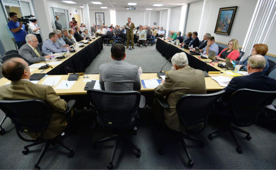 Steve Griffin     Tribune file photo  The Utah Transit Authority board in a meeting in 2014.