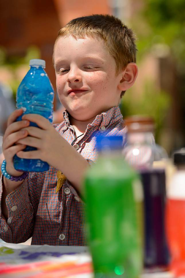 Trent Nelson  |  The Salt Lake Tribune Robert Money, 6, shakes up a bottle he has filled with color and glitter at Westminster Collegeís Tenth Annual Family Fun Day for children with autism and their families in Salt Lake City on Saturday.