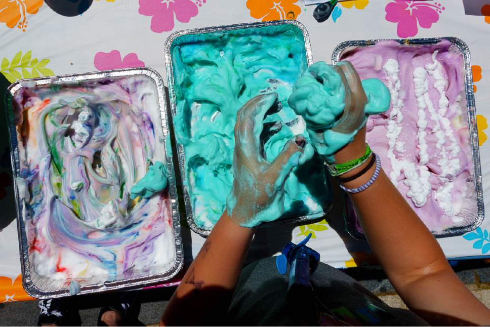 Trent Nelson  |  The Salt Lake Tribune Elspeth Larsen puts her hands in colored shaving cream at Westminster Collegeís Tenth Annual Family Fun Day for children with autism and their families, in Salt Lake City on Saturday.