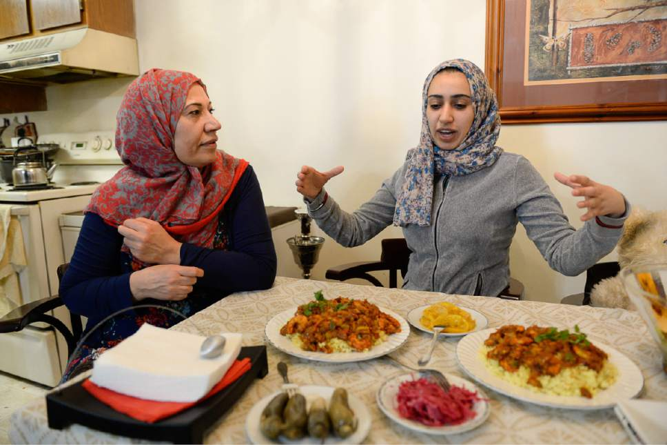 Francisco Kjolseth | The Salt Lake Tribune Baidaa Alshraheb, center, translates for her mother Iman as she discusses traditions of her native Iraq during a meal at their apartment in Salt Lake City recently.