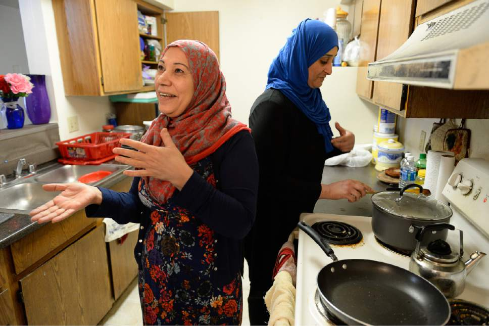 Francisco Kjolseth | The Salt Lake Tribune Iman Alshraheb, left, from Iraq talks about the dish Magbus Rabyan she was about to cook with the help of her friend Wafaa Abdraba during a recent visit to her apartment in Salt Lake City. Alshraheb recalls fond memories of her country and the power of food to bring people together.