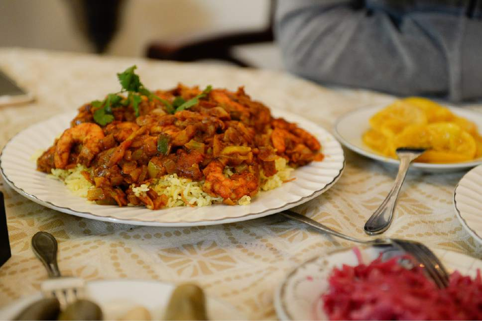 Francisco Kjolseth | The Salt Lake Tribune Magbus Rabyan, an aromatic dish from Iraq filled with spices, shrimp, vegetables and rice is served during a recent meal amongst hospitable refugees giving a glimpse of their culture and customs recently.