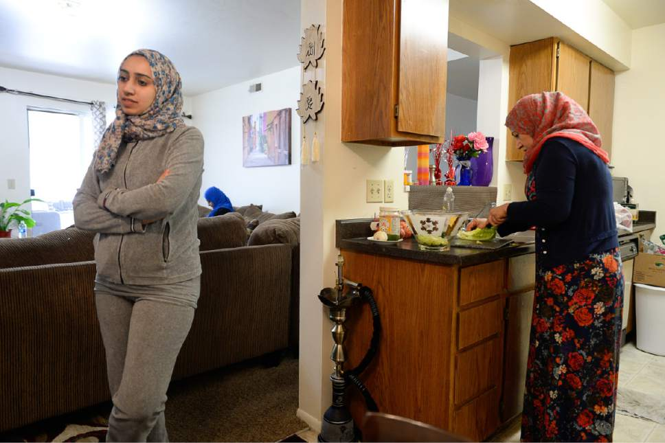 Francisco Kjolseth | The Salt Lake Tribune Baidaa Alshraheb, left, talks about family and culture of her native Iraq as her mother Iman Alshraheb prepares a traditional dish at her apartment in Salt Lake City recently.