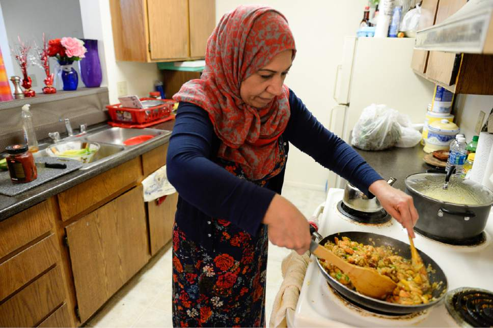 Francisco Kjolseth | The Salt Lake Tribune Iman Alshraheb, from Iraq, prepares a traditional dish called Magbus Rabyan that she cooks often at her apartment in Salt Lake City. Through food Alshraheb engages about her country and culture that she left in search of a better life.
