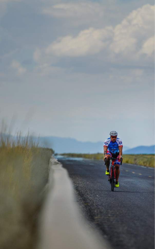 Francisco Kjolseth  |  Tribune file photo   A cyclist rides the frontage road along the Great Salt Lake on Wednesday, July 22, 2015.