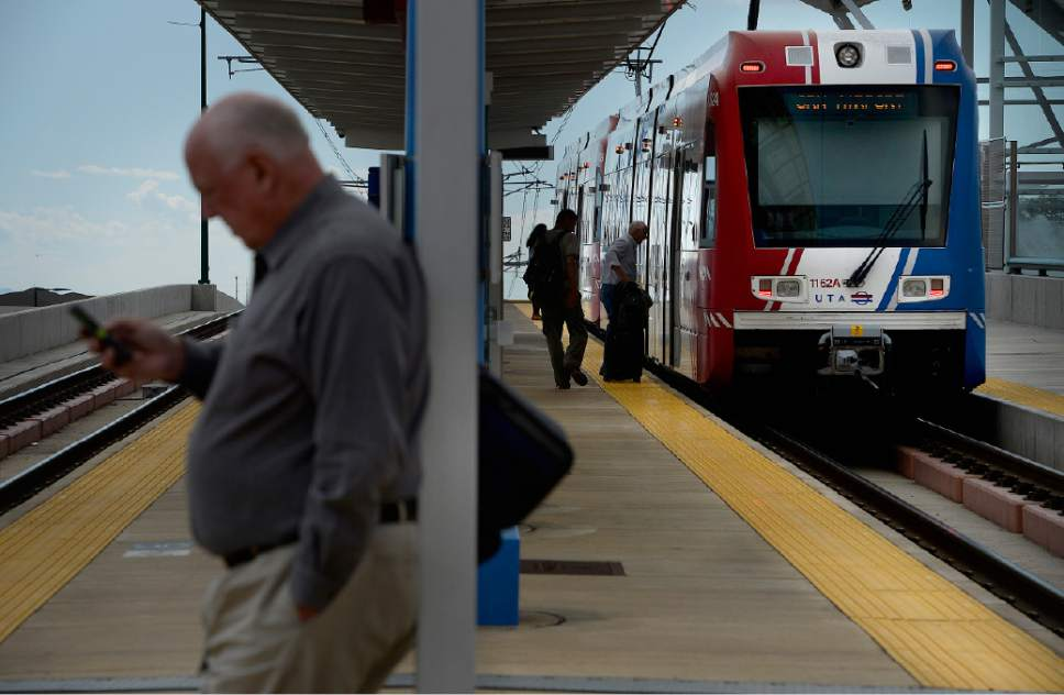 Scott Sommerdorf   |  Tribune file photo Riders board a UTA TRAX train on North Temple that's headed toward the airport, Thursday, June 11, 2015.