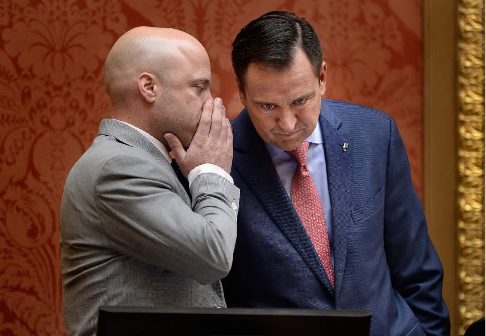 Scott Sommerdorf   |   Tribune file photo Speaker of the House Greg Hughes, R-Draper, confers with his chief of staff Greg Hartley, left, in the Utah House of Representatives, Wednesday, January 25, 2017.