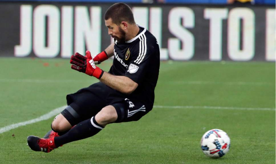 Real Salt Lake goalkeeper Matt Van Oekel (24) cannot stop a goal by FC Dallas forward Tesho Akindele during the first half of an MLS soccer match in Frisco, Texas, Saturday, June 3, 2017. (AP Photo/LM Otero)