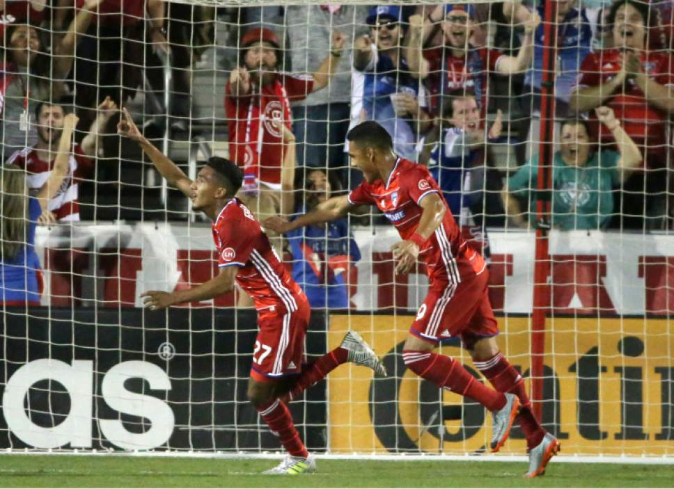 FC Dallas forward Jesus Ferreira (27) celebrates scoring a goal with teammate Cristian Colman (9) during the second half of an MLS soccer match against Real Salt Lake in Frisco, Texas, Saturday, June 3, 2017. (AP Photo/LM Otero)
