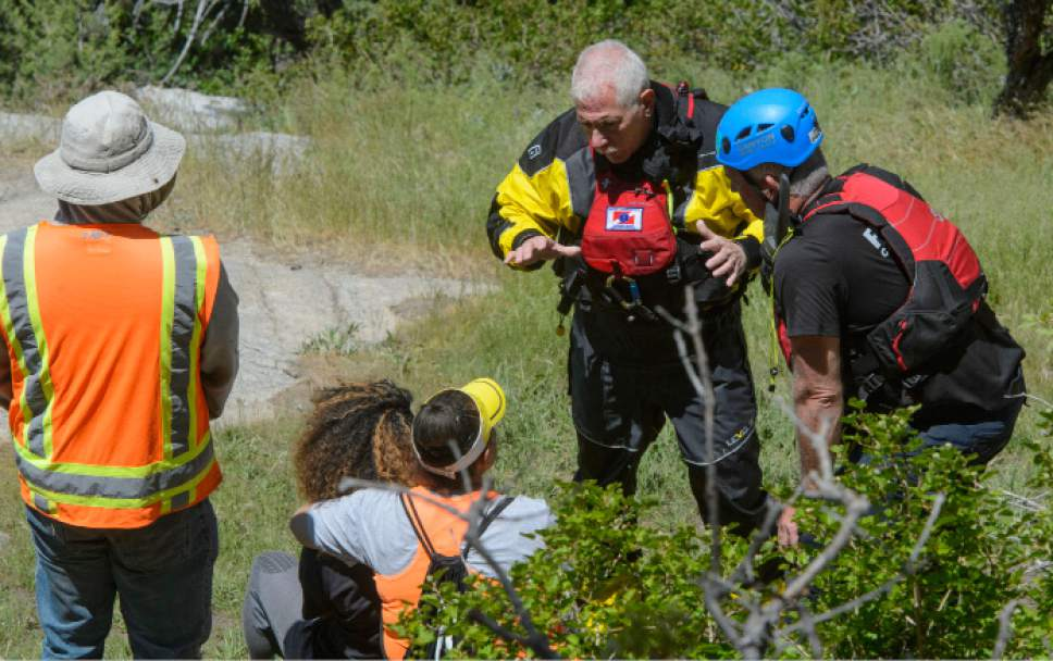 Steve Griffin  |  The Salt Lake Tribune   Salt Lake County Search and Rescue crews talk with family members of 22-year-old Siaosi Brown during a recovery effort for Brown's body after he fell into the runoff-swollen waters of Bell Canyon Creek Sunday evening. Crews called of the rescue efforts as high water levels prevented them from free the body in Salt Lake City Monday June 5, 2017.