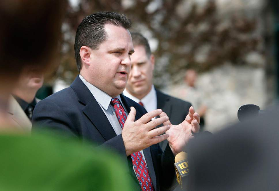 Scott Sommerdorf  |  Tribune File Photo Davis County prosecutor Troy Rawlings announces in a press conference held outside the Davis County Justice Center that his office plans to file aggravated murder charges against Nathan and Stephanie Sloop in connection with the death of 4-year-old Ethan Stacy.