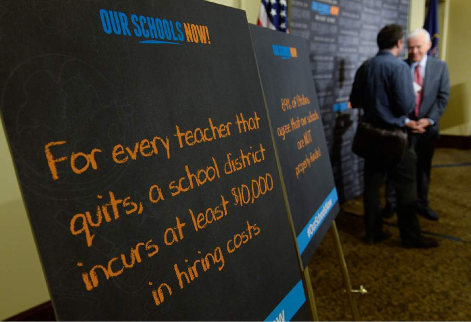 Francisco Kjolseth | The Salt Lake Tribune Poster signs reveal the high cost of teachers quitting following a press event by Our Schools Now who formally launched its tax increase initiative on Tuesday, June 6, 2017, at the Utah Capitol.