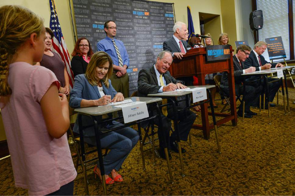 Francisco Kjolseth  |  The Salt Lake Tribune Using school desks as props, and surrounded by teachers of the year and Alpine School District students, Our Schools Now formally launch its tax increase initiative during a press event at the Capitol on Tuesday, June 6, 2017.