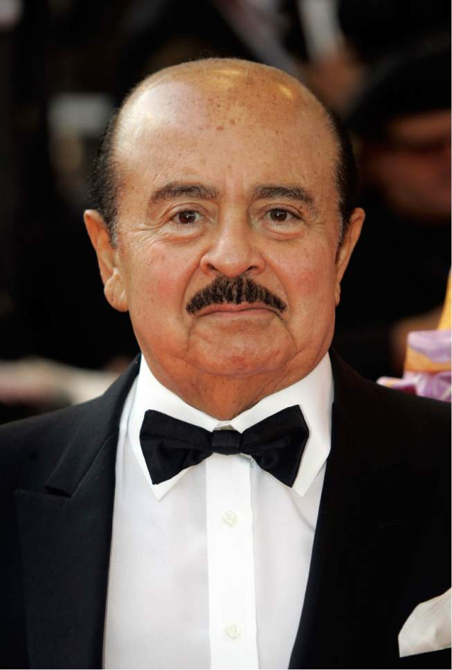 "FILE - In this Wednesday, May 14, 2008 file photo, Adnan Khashoggi arrives at the opening night ceremony and premiere of the film ""Blindness"" during the 61st International film festival in Cannes, southern France. Saudi arms dealer Khashoggi, once one of the world's richest men who was implicated in the Iran-Contra affair, has died. He was 81 and had been suffering from Parkinson's disease, it was reported on Tuesday, June 6, 2017.  (AP Photo/Lionel Cironneau, File)"