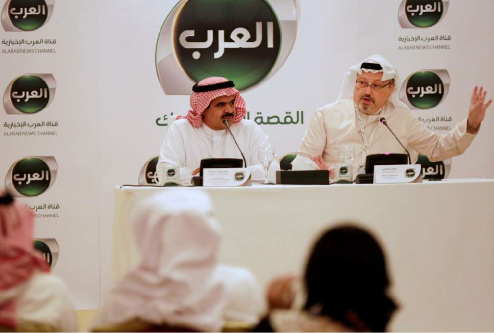 Jamal Khashoggi, general manager of a new Arabic news channel, right, speaks during a press conference with Fahad al-Sukait, chairman of the board and chief executive officer of Alarab TV, left, in Manama, Bahrain, Monday, Dec. 15, 2014.  The Arabic-language station funded by Saudi Prince Alwaleed bin Talal will be based in Bahrain and begin transmission Feb. 1, 2015. (AP Photo/Hasan Jamali)