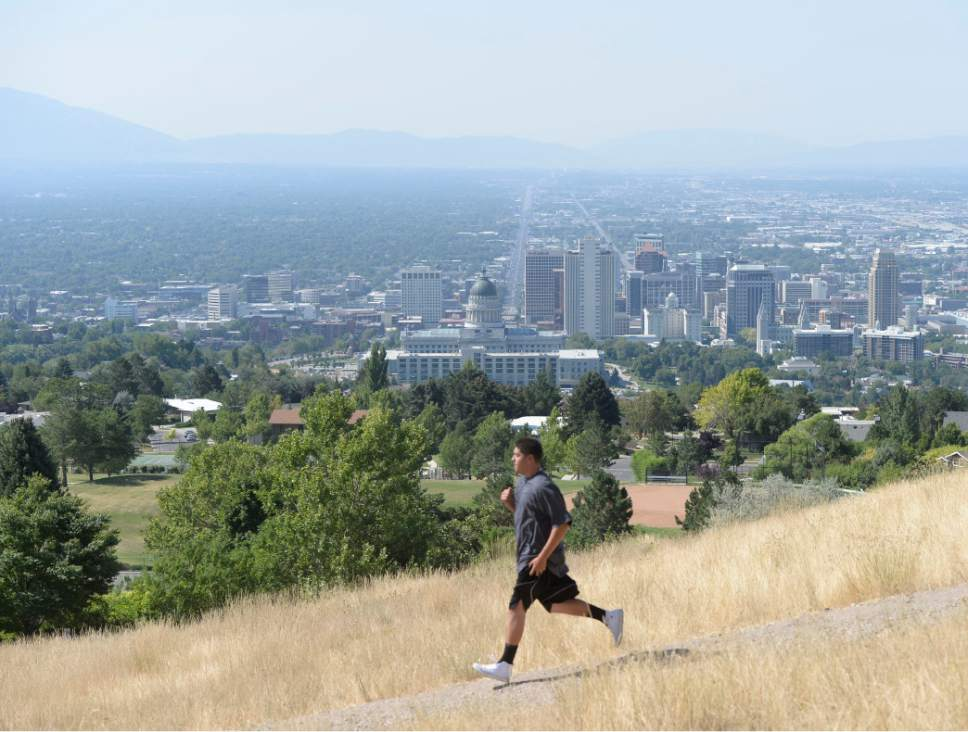 Al Hartmann | Tribune file photo The Salt Lake Valley during a 2016 day when levels of health-threatening ozone levels were high. Lawyers for the U.S. Environmental Protection Agency signaled Tuesday the agency is reconsider a 2015 rule that reduced allowable ozone levels.