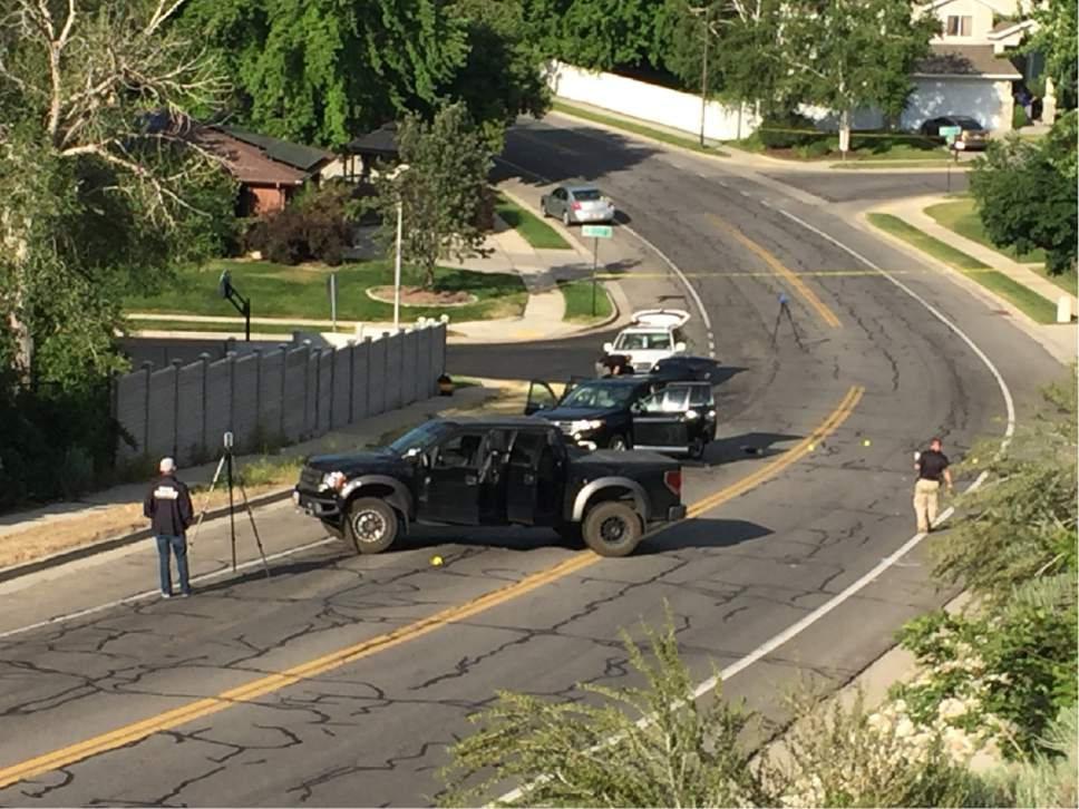Luke Ramseth  |  The Salt Lake Tribune  A man in this black pickup rammed an SUV, shown behind the truck, before he exited and opened fire on the SUV on Sandyís Alta Canyon Drive on Tuesday, June 6, 2017.