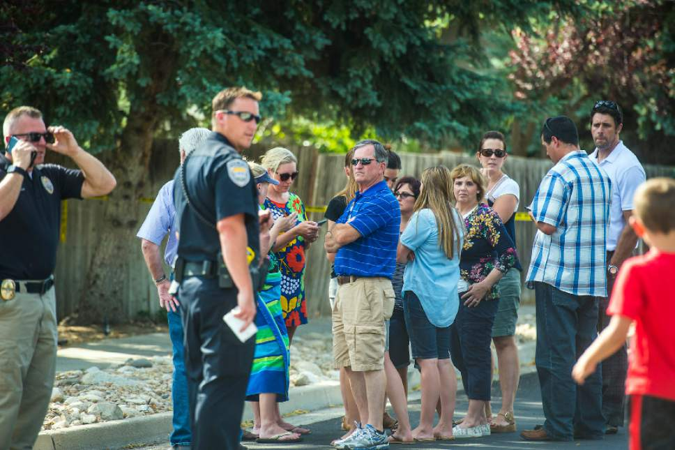 Chris Detrick  |  The Salt Lake Tribune Community members look on as police officers investigate the scene of a shooting Tuesday, June 6, 2017. The shooting occurred at about 3:45 p.m. outside of a residence at about 2175 East and Alta Canyon Drive (about 8630 South), said Sandy police Sgt. Jason Nielsen. Nielsen said the shooter was among the dead and, therefore, there is no threat to the public.