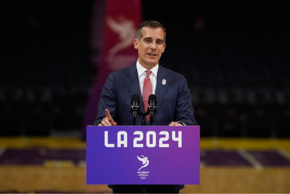 Los Angeles Mayor Eric Garcetti speaks during a news conference at Staples Center, Friday, May 12, 2017, in Los Angeles. The International Olympic Committee officials wrapped up four days of evaluating Los Angeles' bid for the 2024 Games before heading to Paris to check the only other candidate. (AP Photo/Jae C. Hong)
