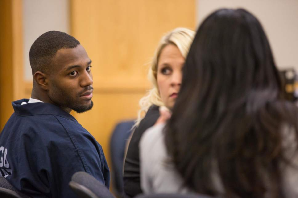 Former Utah State University linebacker Torrey Green leans toward his defense attorney, Skye Lazaro, in the 1st District Court on Thursday € the second day of a three-day preliminary hearing. Green is charged with six counts of rape, one count of aggravated kidnapping, three counts of forcible sex abuse and two counts of object rape. (Tim Carpenter/Utah Statesman)