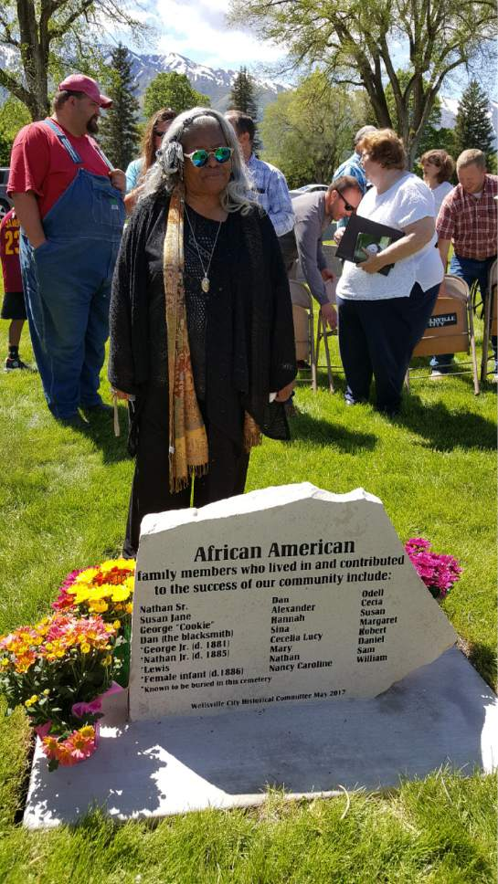 Alice Faulkner  |  Courtesy  Pastor Nurjhan Govan, of the of Trinity A.M.E. Church in Salt Lake City, takes in the the monument dedicated to the members of the 11 slave families who helped pioneers travel and settle in Wellsville.