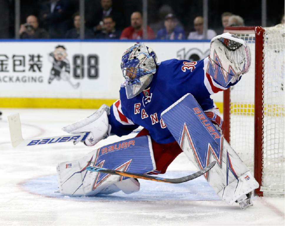 FILE- In this April 16, 2017, file photo, a broken stick flies past New York Rangers goalie Henrik Lundqvist during the third period in Game 3 of an NHL hockey first-round playoff series against the Montreal Canadiens in New York. Despite technological advances that turn carbon fiber into one-piece, fine-tuned machines that are custom made for each NHL player to become extensions of their hands, hockey sticks can still break.  And, sometimes it happens at the worst times.   (AP Photo/Seth Wenig, File)