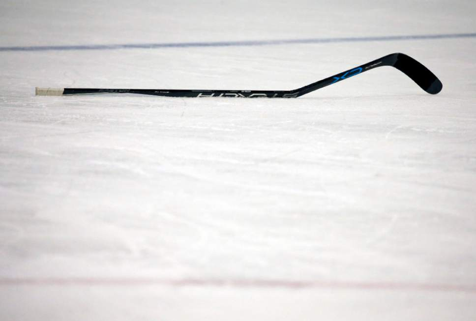 FILE - In this Feb. 4, 2017, file photo, a broken stick rests on the ice during the third period of an NHL hockey game between the Boston Bruins and the Toronto Maple Leafs in Boston. Despite technological advances that turn carbon fiber into one-piece, fine-tuned machines that are custom made for each NHL player to become extensions of their hands, hockey sticks can still break.  And, sometimes it happens at the worst times.  (AP Photo/Mary Schwalm, File)