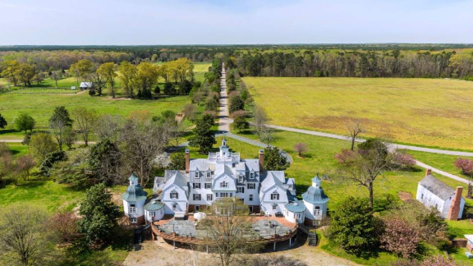 This April 4, 2017 photo provided by John Handcock Productions is an aerial view of Flowered Hundred plantation in Hopewell, Va. The plantation is on of three being sold by the family of West Virginia gov. Jim Justice. (Jim Handcock Productions via AP)