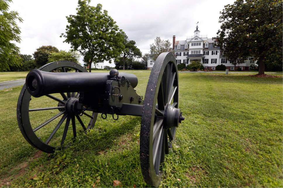 A replica Civil War canon decorates the front lawn of the Flowered Hundred plantation home Wednesday, June 7, 2017, in Hopewell, Va. The plantation is one of three Virginia plantations owned buy the family of West Virginia Gov. Jim Justice that will be put on the auction block later this month. (AP Photo/Steve Helber)