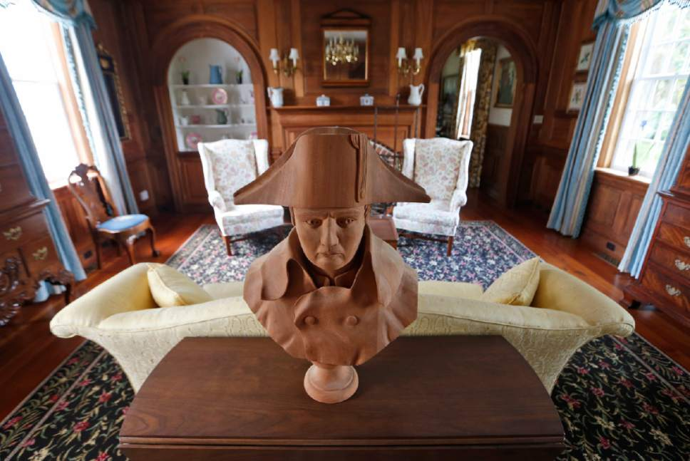 A statue of Napoleon decorates a table in a sitting room at the Flowered Hundred plantation home Wednesday, June 7, 2017, in Hopewell, Va. The plantation is one of three Virginia plantations owned buy the family of West Virginia Gov. Jim Justice that will be put on the auction block later this month. (AP Photo/Steve Helber)