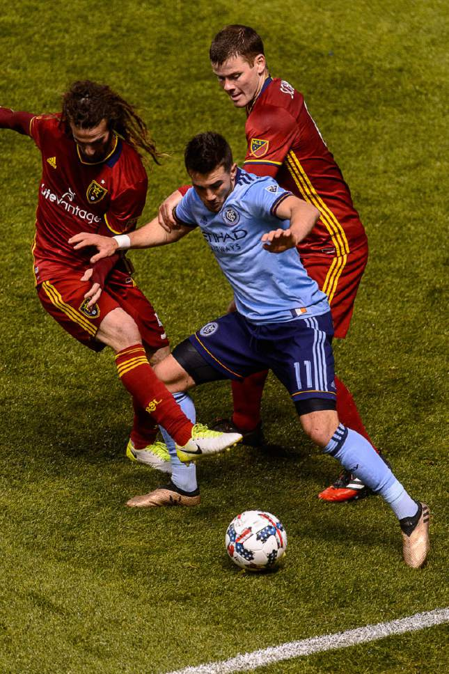Trent Nelson  |  The Salt Lake Tribune Real Salt Lake midfielder Kyle Beckerman (5) and Real Salt Lake defender Justin Schmidt (6) defend New York City FC midfielder Jack Harrison (11). Real Salt Lake vs. New York City FC at Rio Tinto Stadium in Sandy, Wednesday May 17, 2017.