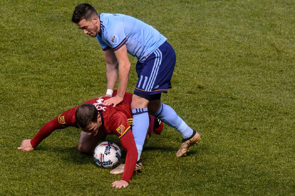 Trent Nelson  |  The Salt Lake Tribune New York City FC midfielder Jack Harrison (11) holds down Real Salt Lake defender Justin Schmidt (6). Real Salt Lake vs. New York City FC at Rio Tinto Stadium in Sandy, Wednesday May 17, 2017.