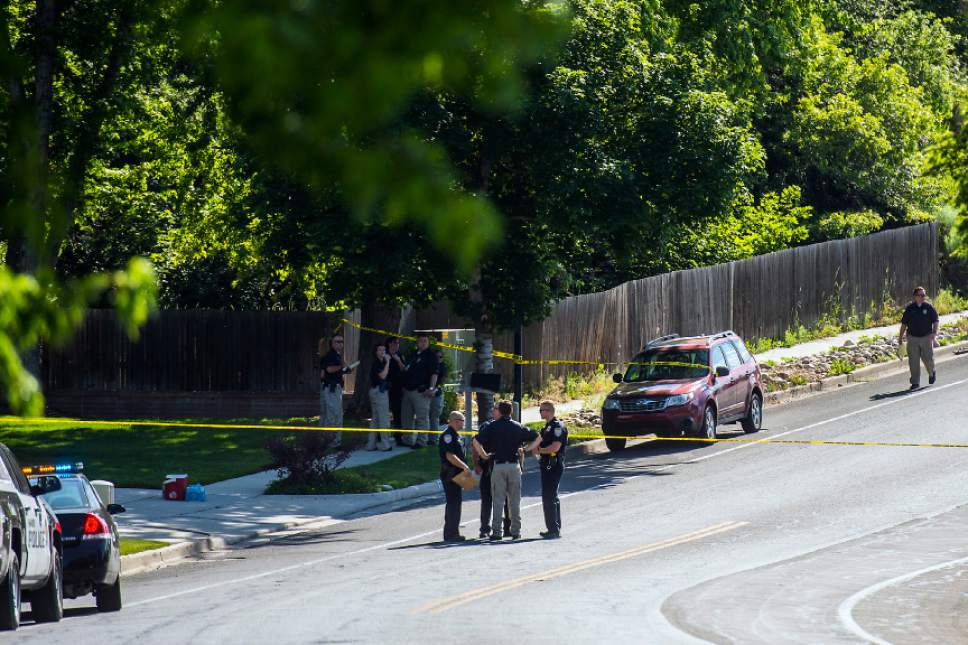 Chris Detrick  |  The Salt Lake Tribune Police officers investigate the scene of a shooting Tuesday, June 6, 2017. The shooting occurred at about 3:45 p.m. outside of a residence at about 2175 East and Alta Canyon Drive (about 8630 South), said Sandy police Sgt. Jason Nielsen. Nielsen said the shooter was among the dead and, therefore, there is no threat to the public.