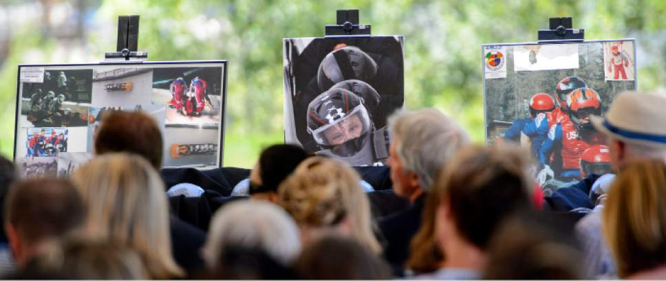 Steve Griffin  |  The Salt Lake Tribune    Photographs of Steve Holcomb surround  the audience as Park City and the Holcomb family and friends hold a memorial to honor the late 37-year-old Park City gold medalist bobsledder who passed away suddenly in Lake Placid last month. The remembrance was held in the summer pavilion at Utah Olympic Park Park City Saturday June 10, 2017.