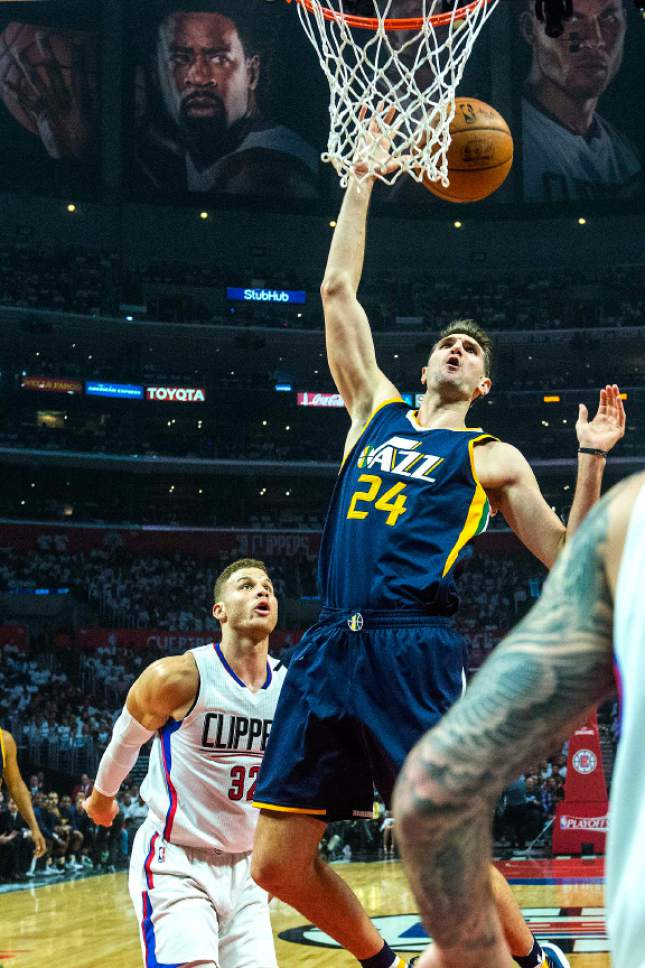 Chris Detrick  |  The Salt Lake Tribune Utah Jazz center Jeff Withey (24) goes for a rebound past LA Clippers guard JJ Redick (4) and LA Clippers forward Blake Griffin (32) during Game 1 of the Western Conference at the Staples Center Saturday, April 15, 2017.