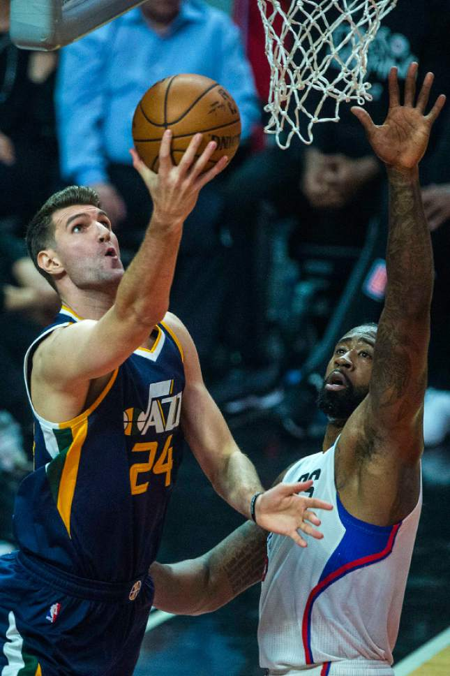 Chris Detrick  |  The Salt Lake Tribune Utah Jazz center Jeff Withey (24) shoots past LA Clippers center DeAndre Jordan (6) during Game 1 of the Western Conference at the Staples Center Saturday, April 15, 2017.