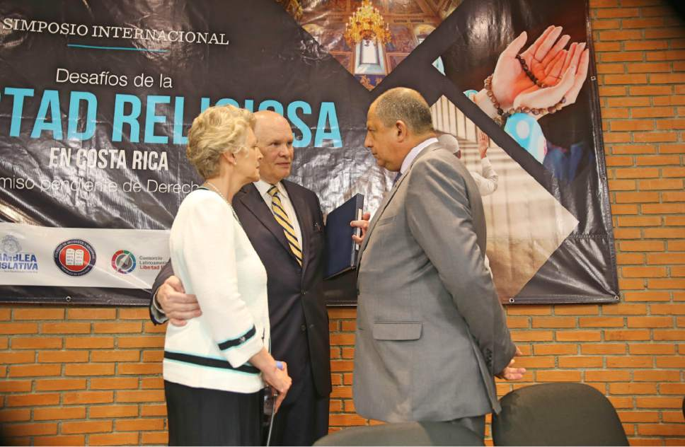 photo courtesy LDS Church Elder Dale G. Renlund of the Church's Quorum of the Twelve Apostles and his wife, Ruth Lybbert Renlund, met briefly with Hon. Luis Guillermo Solís Rivera, president of the Republic of Costa Rica. They participated in a day-long international religious freedom symposium in Costa Rica, June 9, 2017.