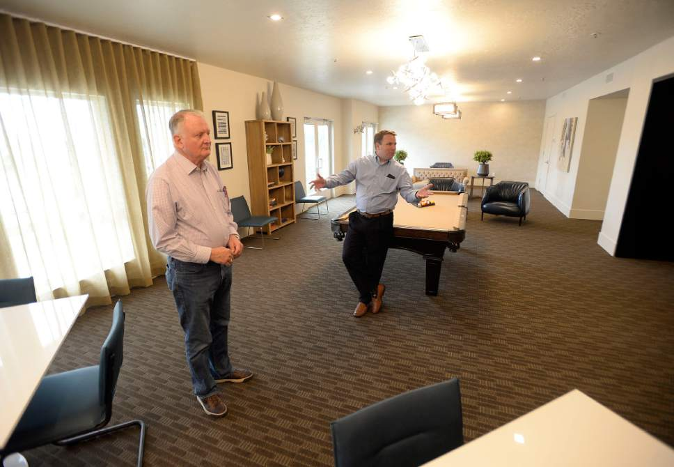 Al Hartmann  |  The Salt LakeTribune Hooper Knowlton, left, and son Bill Knowlton in the common room at Artesian Springs, a new affordable housing project at 4200 S. Main St. in Murray.  The apartments haver been developed on the site of the old Murray Laundry tower .