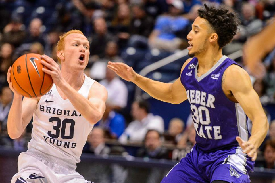 Trent Nelson  |  The Salt Lake Tribune Brigham Young Cougars guard TJ Haws (30) is defended by Weber State Wildcats guard Jeremy Senglin (30) as BYU hosts Weber State, NCAA basketball at the Marriott Center in Provo, Wednesday December 7, 2016.