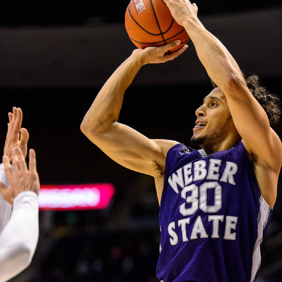 Trent Nelson  |  The Salt Lake Tribune Weber State Wildcats guard Jeremy Senglin (30) puts up a shot as BYU hosts Weber State, NCAA basketball at the Marriott Center in Provo, Wednesday December 7, 2016.