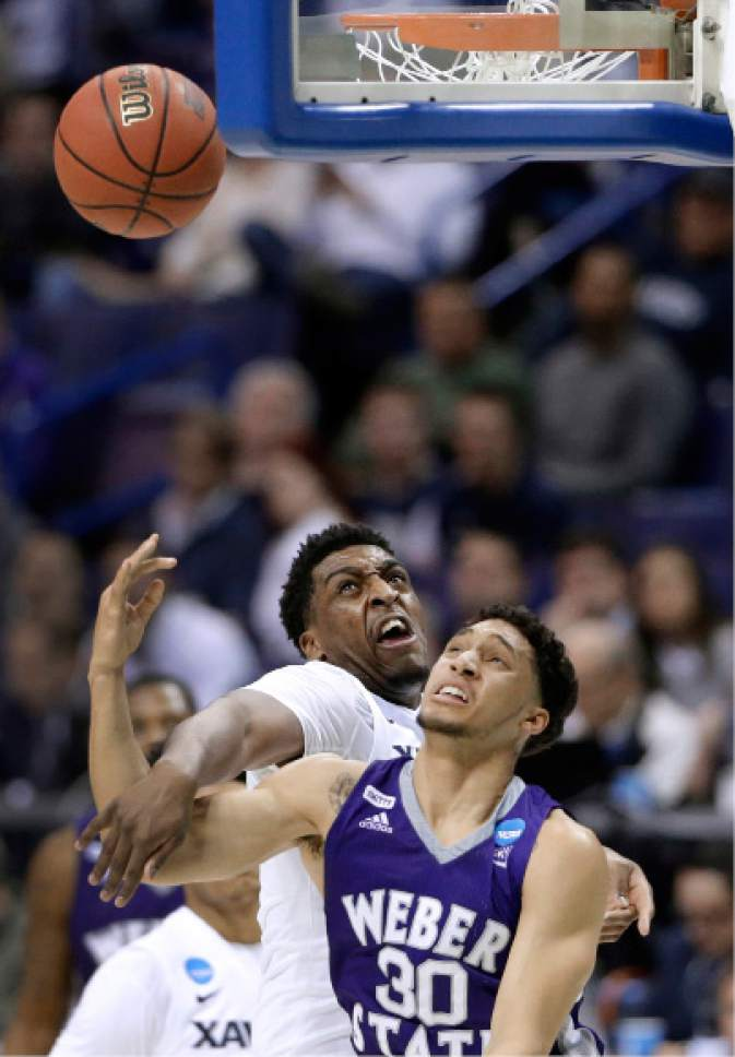 Weber State's Jeremy Senglin (30) puts up a shot as Xavier's James Farr defends during the first half in a first-round men's college basketball game in the NCAA tournament, Friday, March 18, 2016, in St. Louis. (AP Photo/Jeff Roberson)