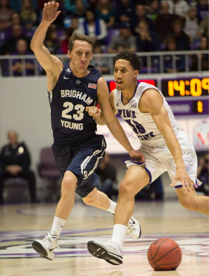 Rick Egan  |  The Salt Lake Tribune  Brigham Young Cougars guard Skyler Halford (23) tires to keep up with Weber State Wildcats guard Jeremy Senglin (30), in basketball action BYU vs Weber State, at the Dee Events Center in Ogden, Saturday, December 13, 2014