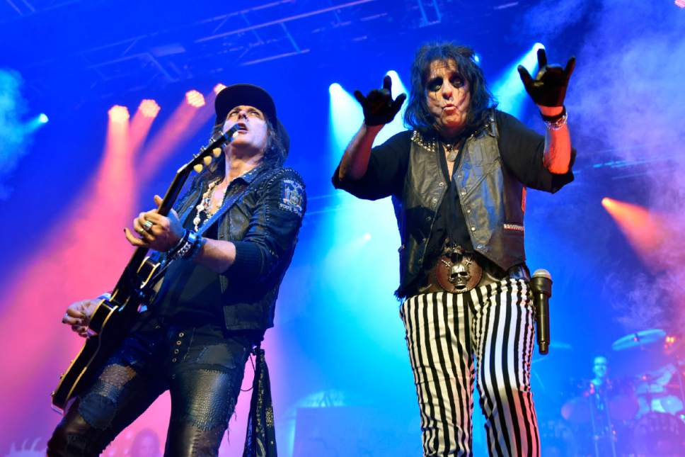 """Alice Cooper performs with Ryan Roxie during the """"An Evening With Alice Cooper Tour"""" at Star Plaza Theatre on Thursday, May 5, 2016, in Merrillville, Ind. (Photo by Rob Grabowski/Invision/AP)"""