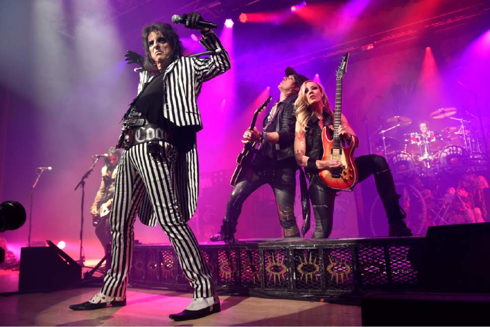 """Alice Cooper performs with Nita Strauss and Ryan Roxie during the """"An Evening With Alice Cooper Tour"""" at Star Plaza Theatre on Thursday, May 5, 2016, in Merrillville, Ind. (Photo by Rob Grabowski/Invision/AP)"""