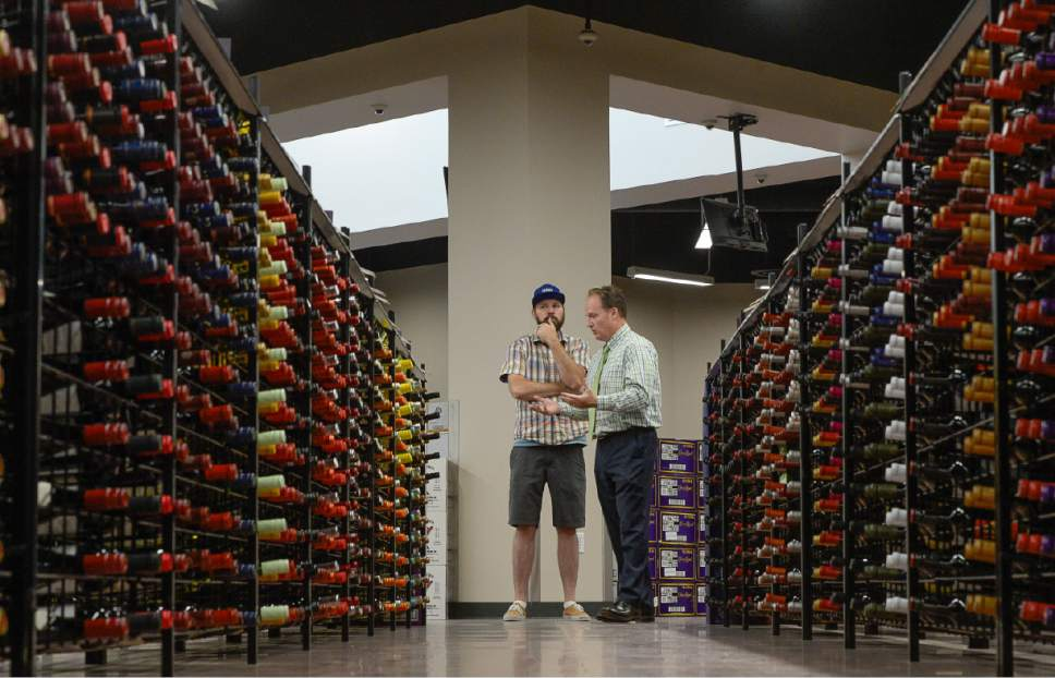Francisco Kjolseth | The Salt Lake Tribune Brett Smith, left, a vendor with the DABC, speaks with Cade Meier, Deputy Director of the DABC at Utah's 45th liquor store, the first built in seven years, scheduled to open Tuesday in West Valley City. On Monday, June 12, 2017 staff were busy putting the finishing touches on the store that features 13,500 square feet of space stocked with 40 percent beer, 40 percent liquor and 20 percent wine.