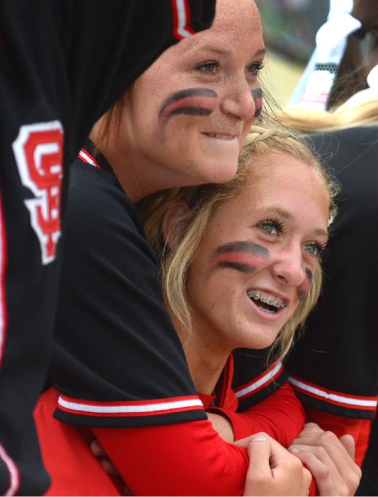 Steve Griffin     The Salt Lake Tribune   Spanish Fork pitcher Cambrie Hazel is hugged by a teammate as they watch the bottom of the seventh inning from the dugout during the 4A softball championship game between Maple Mountain and Spanish Fork at th eValley Softball Complex in Taylorsville, Friday, May 22, 2015.